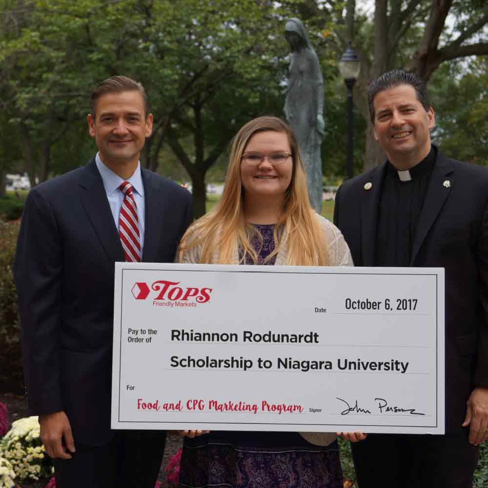 Student holding scholarship check